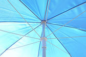 Blue sunblock umbrella — Stock Photo