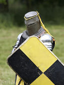 Medieval knight with shield — Stock Photo