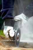 Worker cutting with an angle grinder — Stock Photo