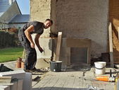 Building an outdoor fireplace — ストック写真