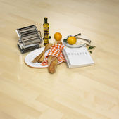 Kitchen belongings on bright parquet — Stock Photo