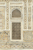 Detail of marble wall with Inlay work and window — Stock Photo