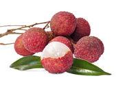 Fresh lychees with leaves isolated on white background — Stock Photo