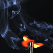 Ignition of match with smoke, isolated on black background — Stock Photo