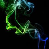 Colorful smoke on black background — Stock Photo