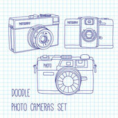 Set of three hand drawn photo cameras. — Stock Vector