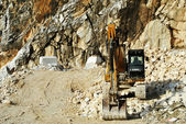 Bulldozer at rest in a quarry marble — Stock Photo