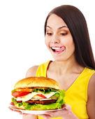 Frau Holding hamburger