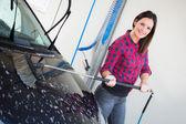 Young Woman Washing Car