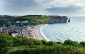 Scenic view of Etretat town with its beach and famous cliffs wit