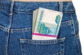 Balíček bankovek ruský Rubl v kapse zadní džíny
