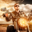 Постер, плакат: Biker on a motorcycle