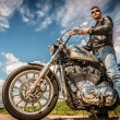 Постер, плакат: Biker on bike Harley Sportster