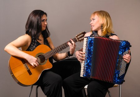 Постер, плакат: Guitar and accordion performers, холст на подрамнике