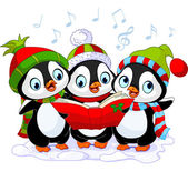 Three cute Christmas carolers penguins