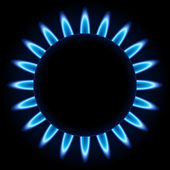 Blue flames ring of kitchen gas burner isolated on black background