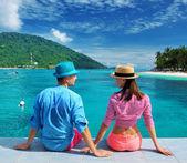 Couple at beach jetty