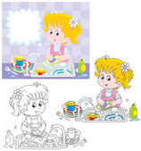 Little girl washing dishes in a kitchen