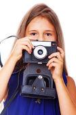 Portrét krásné puzzle dívka pózuje na bílém pozadí s fotoaparátem