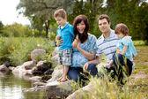 Family Near Lake in Park