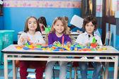 Children Playing With Construction Blocks In Kindergarten