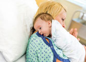 Babygirl Resting On Mother's Shoulder In Hospital
