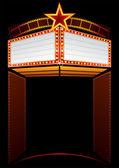 Entrance to cinema with big neon