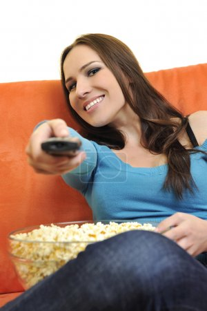 Постер, плакат: Woman eat popcorn watching movies, холст на подрамнике