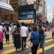 Постер, плакат: Pedestrians in Causeway Bay district Hong Kong