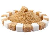 Sugar cube on a heap of granulated sugar