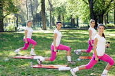 Group of smiling women doing exercise
