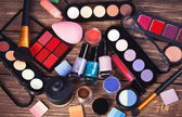 Cosmetics on wooden table.