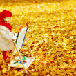 Постер, плакат: Autumn Baby Girl Drawing in Fall Leaves Park Kid Painting