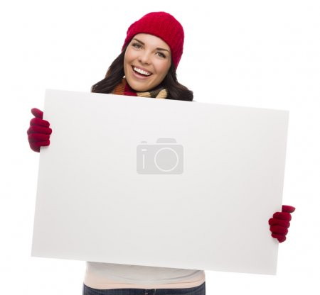 Excited Girl Wearing Winter Hat and Gloves Holds Blank Sign