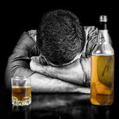 Black and white image of a drunk man sleeping