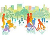 Rodiny s dětmi jsou procházky v parku
