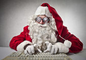 Father Christmas typing on a computer