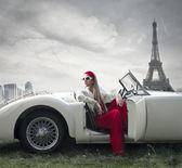 Fashion woman on a car
