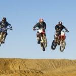 Постер, плакат: Motocross Racers in mid air