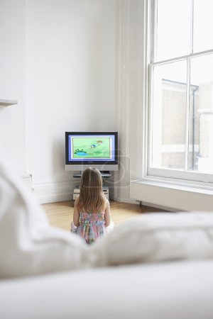 Постер, плакат: Girl watching cartoons in television, холст на подрамнике