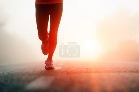 Athlete running road silhouette
