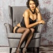 Постер, плакат: Beautiful young mulatto woman in black lingerie and stockings