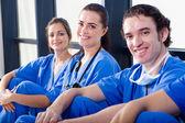 Group of medical nurses resting during break