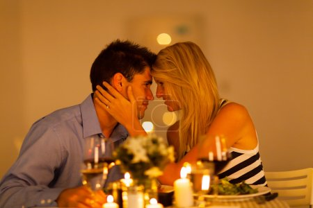 Young loving couple having romantic dinner together
