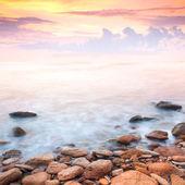 Beautiful sunrise over the rocky sea coast