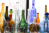 Collection of colorful vintage bottles