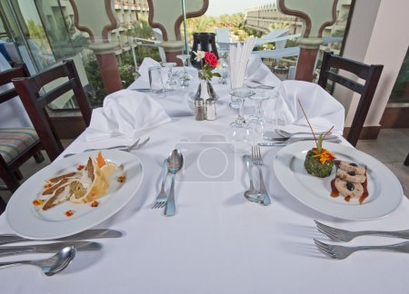 Постер, плакат: Two meals in an a la carte restaurant, холст на подрамнике