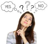 Young woman think with yes or no choice looking up isolated on w