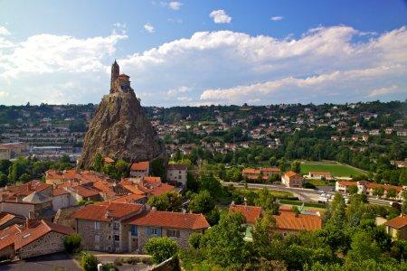 Ancient Chapelle Saint Michel de Aiguilhe standing at a very steep volcanic needle (Le Puy en Velay, France)