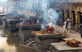 Nepalese burning corpses in Pashupatinath Temple in Katmandu, Nepal.
